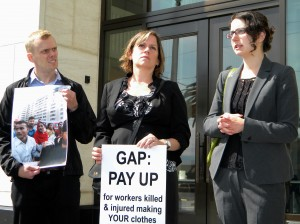 Martin Caldwell (sumofus.org), Sara Steffens (The Newspaper Guild) and Sara Church (International Labor Rights Forum) speak outside of The GAP's annual shareholder meeting in protest of GAP's refusal to join in an accord that protects workers and their health and safety.  Photo by Staff 2014.