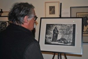 A visitor to the Mexican Museum views one of the Guild's Mendez print on special exhibit on July 8 during LaborFest activities.  The artist made the print from a linocut in 1950.  Photo by Kat Anderson 2014.