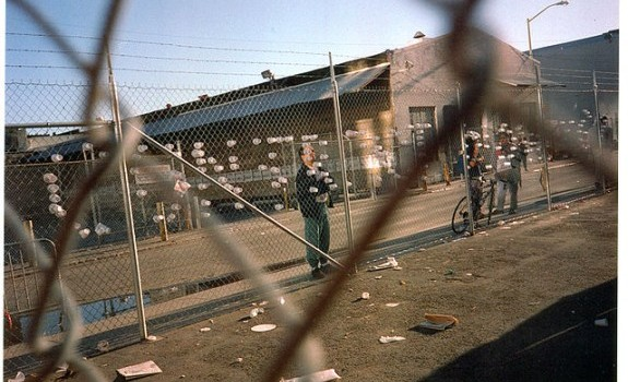 "Strikers pushed cups in the Chronicle fence to spell out ""Contract now."" Photo by Nancy Wong 1994."