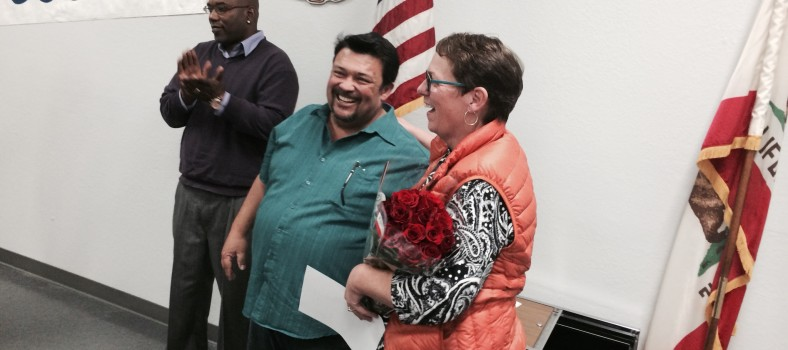 New officers were sworn in to start the February 4 meeting of CWA's Northern California-Nevada Council. Outgoing NCNC president Carol Wichard got a bouquet in gratitude from her successor, Frank Arce, while the new executive Vice President, Keith Gibbs, led delegates in a round of applause. (Photo: PMWG 39521)