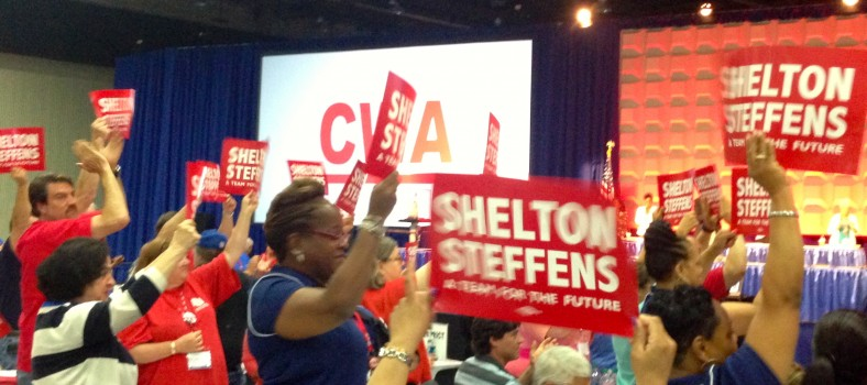 CWA members rally behind Chris Shelton and Sara Steffens at the 75th Convention in Detroit. Photo by Kat Anderson 2015